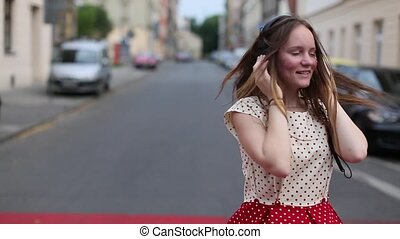Cute teen girl enjoying music