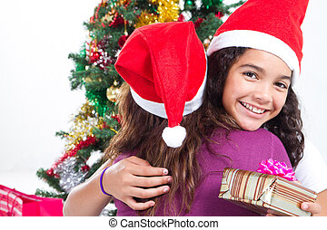 girl hugging mother on Christmas
