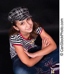 Cute teen girl in jeans.