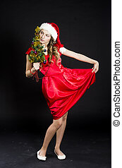 cute teen girl in santa claus costume