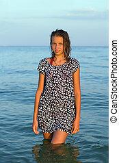 cute teen girl in wet dress