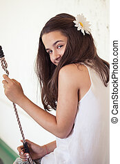 cute teen girl on swing