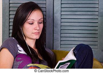 Cute Teen Girl Reading a Book