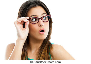 Close up portrait of cute teen girl wearing glasses looking aside. Isolated on white.
