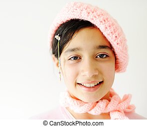 Cute teen girl with pink hat