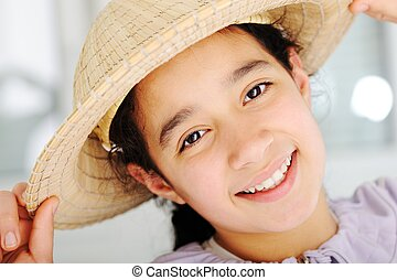 Cute teen girl with straw hat