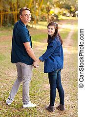 cute teenage couple holding hands