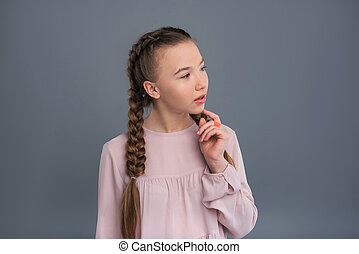Cute teenage girl looking away while thinking