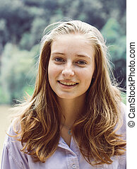 Cute teenage girl with blond hair