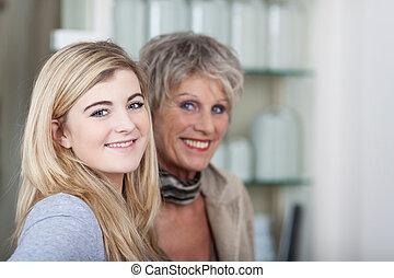 Cute teenage granddaughter with her grandma - Beautiful...