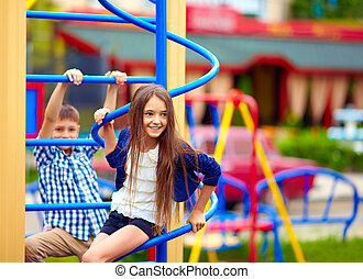 cute teenage kids having fun on playground