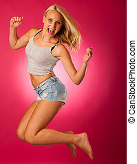 cute teenage woman over pink background