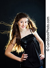 cute teenager girl with beautiful long dark hair on black -...