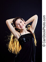cute teenager girl with  beautiful long dark hair  on black
