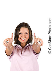 Cute teenager girl with thumbs-up