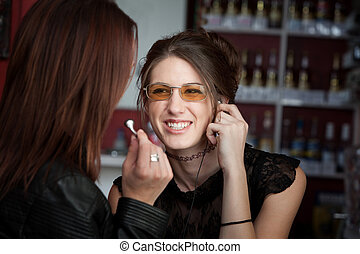 Cute Teens Listening to Music - Young cute looking teen...
