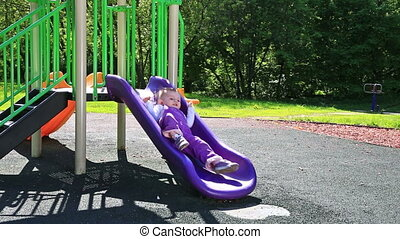 Cute toddler at playground in sunny day