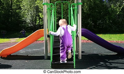 Cute toddler at playground in sunny day - Positive toddler...