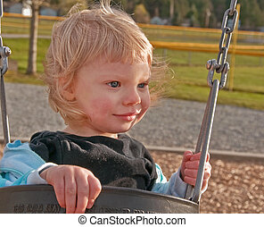 Cute Toddler Eighteen Month Old in Swing