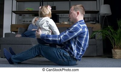 Cute toddler girl bonding with loving dad at home