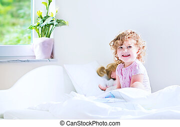 Cute toddler girl waking up - Funny curly toddler girl...