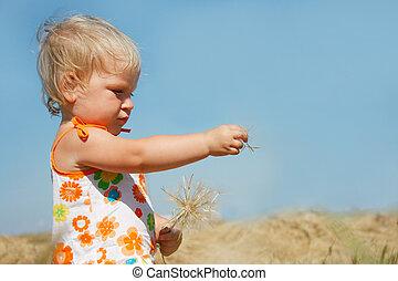 cute toddler girl with big dandellion