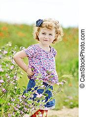 cute toddler in field
