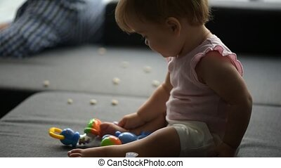 Cute toddler playing on the sofa