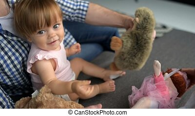 Cute toddler playing with caring father at home