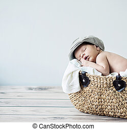 Cute tot sleeping in a basket