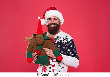 Cute toy of Christmas. Happy santa hold reindeer toy. Bearded man with soft toy. Holiday toy gift. New Year present. Boxing day. Christmas surprise. Play and game during holiday season
