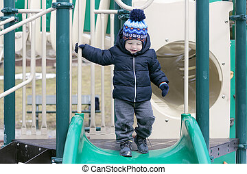 Cute two years toddler on the playground
