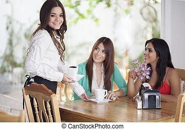 Cute waitress serving coffee