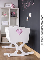 Cute white cradle in nursery room