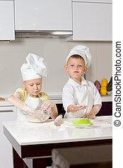 Cute White Little Chefs Baking in Kitchen