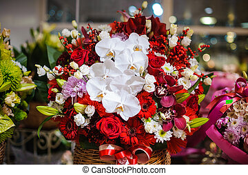 Cute wicker basket with beautiful and colorful flower composition