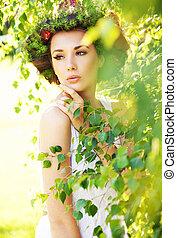 Cute woman among greenery