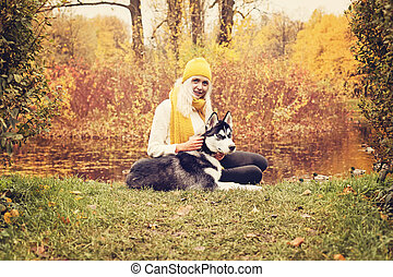 Cute Woman and Husky Dog in the Autumn Park Outdoors