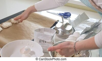 Cute woman baking in her kitchen