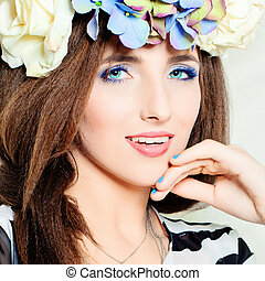 Cute Woman. Beautiful Blue Makeup. Hair with Summer Flowers