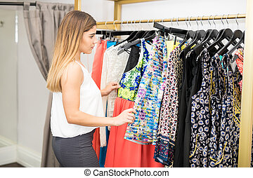 Cute woman buying some clothes
