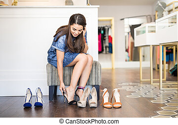 Cute woman buying some high heels