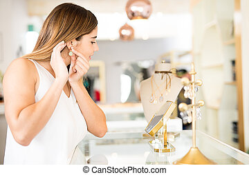 Cute woman buying some jewelry