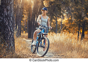 cyclist cycling mountain bike on Pine forest trail
