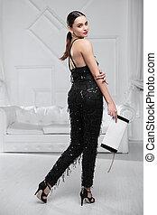 Cute woman dressed in black