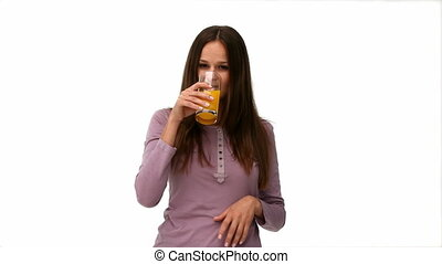Cute woman drinking orange juice against a white background