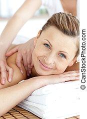 Cute woman enjoying a back massage
