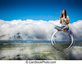 Cute woman flying in the sky on big soap bubble
