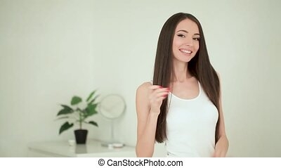 Cute woman gesturing thumb up. Beautiful young lady smiling...