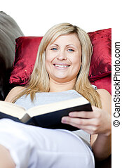 Cute woman holding a book